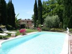 The lawned terrace with pool is surrounded by a magnificent garden