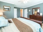 master bedroom with sleigh bed, walk-in closet, attached bathroom