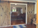The barn doors on the porch you can close to make the porch a 3rd bedroom