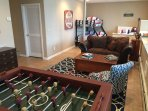 Bungalow Room sleeps 2-3 and has Foosball table, games, a full bathroom and and a leather sofa