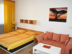 Living room / beroom. Sitting area. The folding sofa can be arranged as an additional bed,
