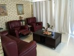 Relax in the lounge room after a long day out and rest your feet.