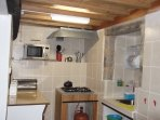 KITCHEN - FULLY EQUIPPED WITH COOKER, OVEN AND GRILL, MICROWAVE, TOASTER, COFFEE-MAKER, KETTLE etc