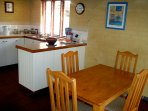 Kitchen is clean and bright with cooktop and under beach oven. Large refrigerator.