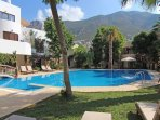 The super 185m2 shared pool and mountain views,.