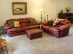 Family room offers oversized leather seating- comfy enough for sleeping. (Cable Tv & Wii)