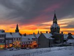 The High Street and Townhouse on a wintry sunset