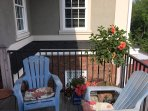 Back balcony enjoys the southern sunshine and a gas grill.