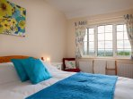 A cosy & colourful two bedroom cottage with stunning views.  Ideal for a small family