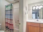 The en suite full bathroom allows for total comfort and convenience.