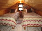 One of the adorable, cozy upstairs bedrooms. Has 2 twin beds & a roomy dresser