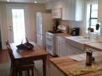 country kitchen with big farm sink and retro style appliances