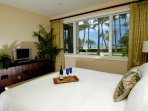 Ocean view ensuite master bedroom with king bed