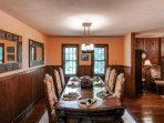The formal dining table offers ample seating for the group.