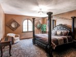Climb under the covers of the king bed in the master bedroom.