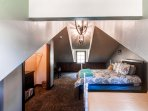 The room features a queen bed and 2 twin beds.