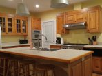 Cottage B Kitchen with 6 burner gas range and a warming drawer.