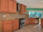 You'll love preparing home-cooked meals in the fully-equipped gourmet kitchen.