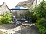 Pretty sunny cottage garden with dining area