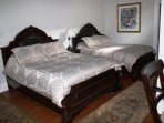 Bedroom 2 features 2 Queen sized beds. HDTV & phone service. Office desk, side entrance/exit