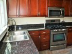 Entrance to the the house is through the kitchen.Granite/stainless steel appliances. Gas stove