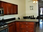 L-shaped kitchen. Gas stove. Fully equipped kitchen. Including FREE coffee and spring water bottles.