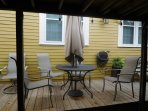 closer view of outdoor furniture. Seating for 6. An unbrella is available all year round. Privacy