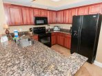 Fully equipped kitchen with blender, toaster oven, coffee pot and landline phone