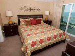 Master bedroom with carpeting, king bed and private access to Gulf-front balcony