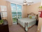 Guest bedroom with queen bed and lagoon view