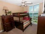 Guest bedroom with duo bunk bed (twin on top, full on bottom) with additional trundle