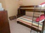 Carpeted guest room with duo bunk and trundle