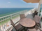 Space for dining and lounging on this Gulf-front balcony