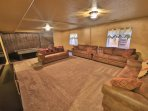 Very large TV/Game room with one sofa bed and one daybed that includes a trundle bed.