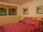 smaller bedroom with built-in queen-sized bed and built-in side tables; mattress warming pad