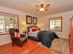 Large master bedroom has a queen sized bed with high thread count designer linens and soft pillows.