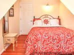 Upstairs bedroom 1 has a queen bed with designer sheets, soft blankets and great pillows.