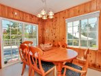 The kitchen table is a great place to dine, play cards or play board games.