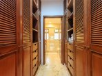Walk-through Closet provides a personal combination Safe to secure your valuables.