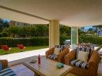 Spacious terrace with lounge area, rattan sofa