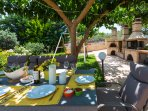 Fully equipped barbecue area and Dining area under the tree shadows
