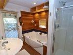 Rembach - Elegant Spa-like Hall Bath on 2nd Floor