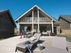 Extremely popular seaside property only 50m from the beach with outside decking for dining.