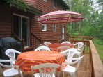 2 outside decks with grill and patio furniture