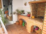 Lovely brick built bbq and sink area in summer kitchen