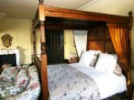 'Yellow' bedroom is another of the many four poster bedrooms