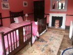 'Pink' twin room on the first floor with an ensuite bathroom