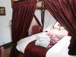 'Grey' double room with four poster bed on the first floor