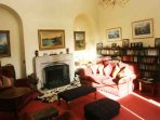 The other sitting room offers comfortable seating and is more cosy