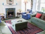 The drawing room is lovely with comfy sofas, views in three directions and doors to the terrace